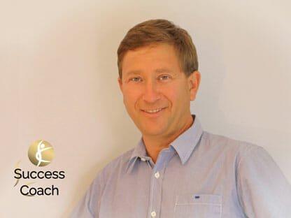 Success Coach Dr. Wiesinger mit Logo